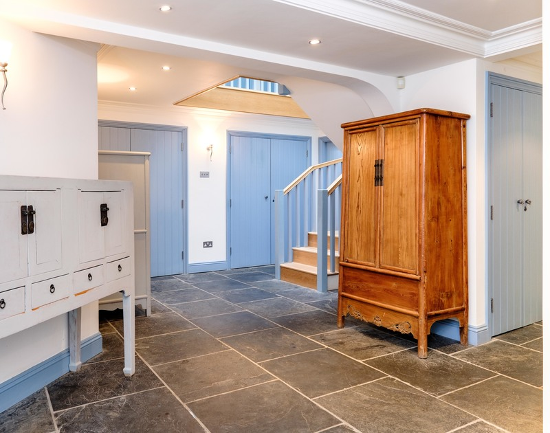 The spacious, welcoming ground floor entrance at Old Brea Coach House, a luxurious holiday home in Daymer Bay.
