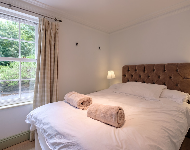 one of the ground floor double bedrooms at Old Brea Coach House. Bright room with large sash windows.