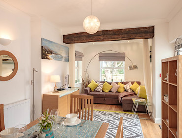 Characterful original beam in the open plan living area at self catering holiday apartment St Martins part of Lundy House on the Rock Road in North Cornwall.
