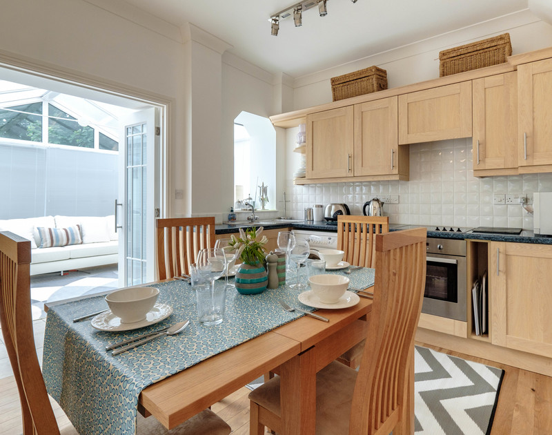The fitted kitchen and dining table at St Martins, a self catering holiday apartment, ideal for a small family break or a romantic couples getaway.