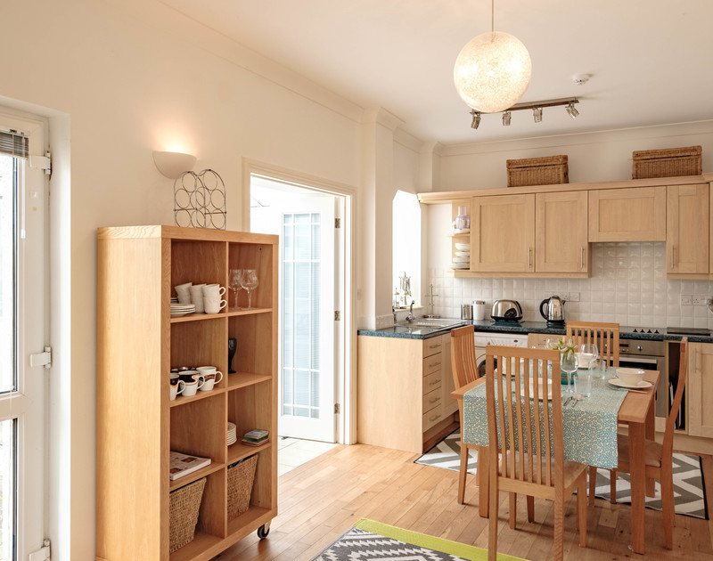 Good natural light in St Martins apartment through the open plan kitchen, dining and living room areas.
