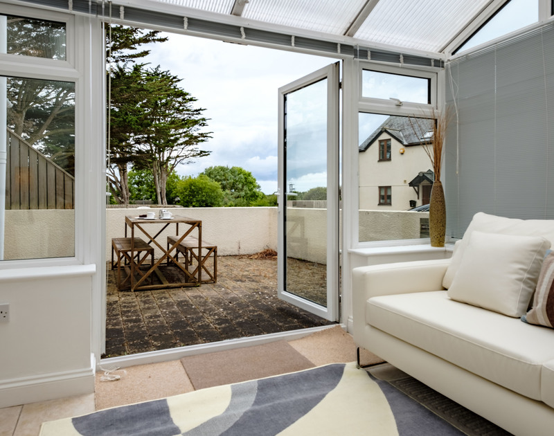 Open the patio doors and take food or drinks out to the private patio area at self catering holiday apartment St Martins in Rock, Cornwall.