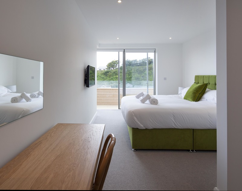 The master bedroom at Slatewater has access to the balcony and an ensuite shower room.