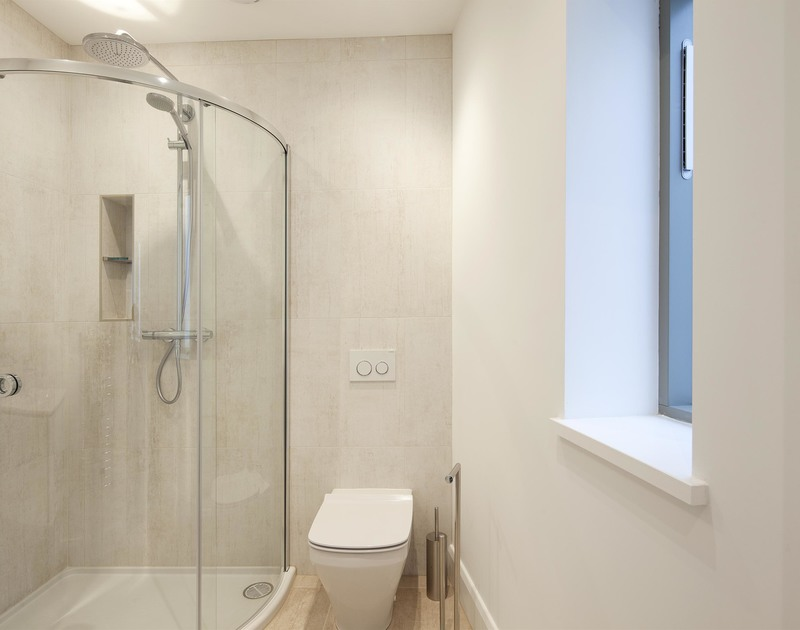 Functional and stylish shower ensuite for the king size bedroom at luxury, self catering Slatewater in Polzeath, Cornwall.