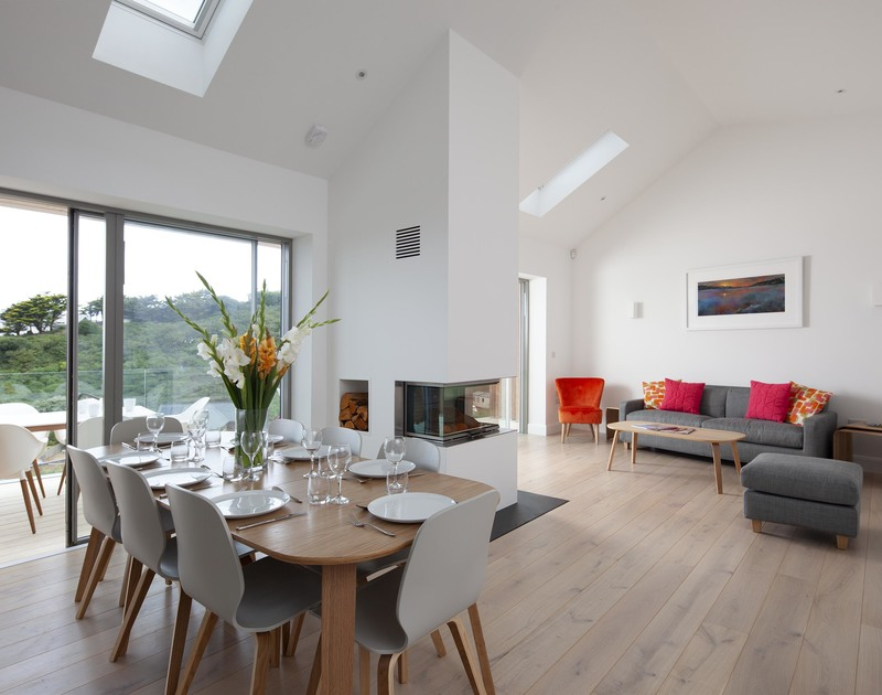 Striking, modern interior in the open plan living ares at Slatewater, a luxury holiday rental in Polzeath, Cornwall.