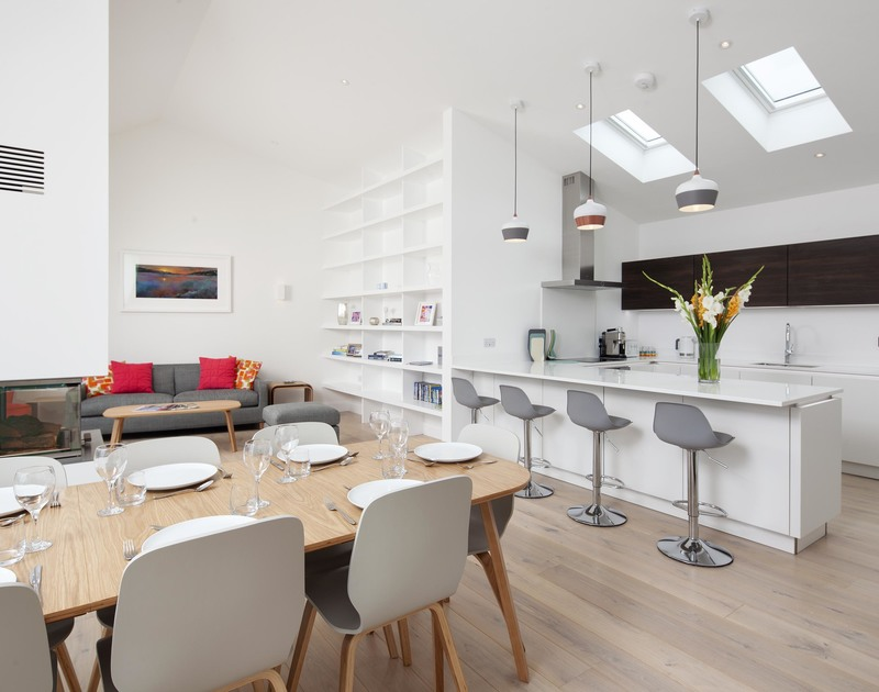 The bright and contemporary open plan  kitchen and dining area in Slatewater, a luxury self catering, holiday home in Polzeath, Cornwall.