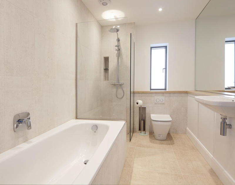 The family bathroom with separate bath and shower enclosure at Slatewater, a luxurious holiday rental in Polzeath in Cornwall.