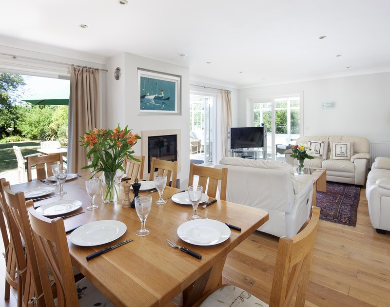 The smart open-plan dining space next to the kitchen at Saltrock, a holiday house in Rock, Cornwall