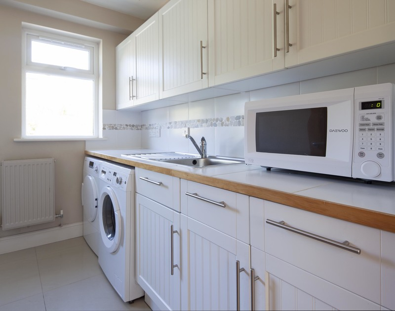 Well equipped utility room at Saltrock, a self catering, holiday house near the Camel Estuary in Rock.