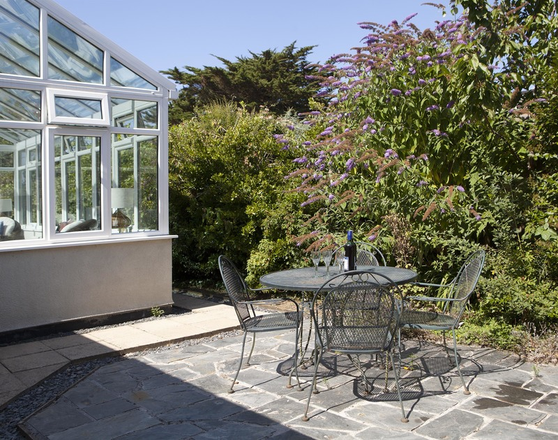 Follow the sun around the garden at holiday rental Saltrock and pull up a chair for a glass or two.