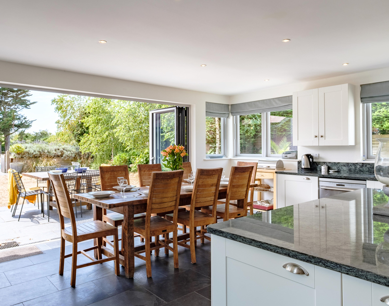 On warm days, let the outside in by fully opening the huge folding doors in the kitchen/dining room at Trerokken, close to the Camel Estuary in Rock, Cornwall.