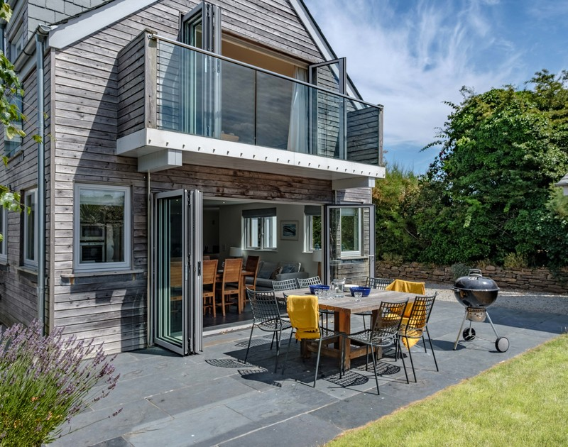 Merge the kitchen and garden by fully opening the bifold doors at Trerokken