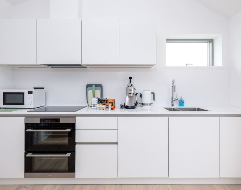 Cook up some delicious meals in the bright kitchen area in Backwater, a contemporary holiday rental in Polzeath, Cornwall.