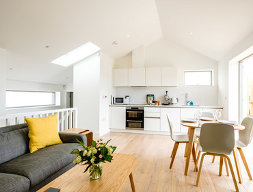 The first floor open plan space in Backwater, a luxury, holiday house above the beach at Polzeath in Cornwall.