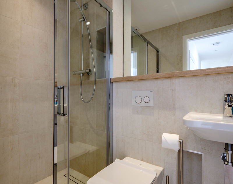 The luxurious modern shower room at Backwater, a holiday home to rent close to the sea in Polzeath.