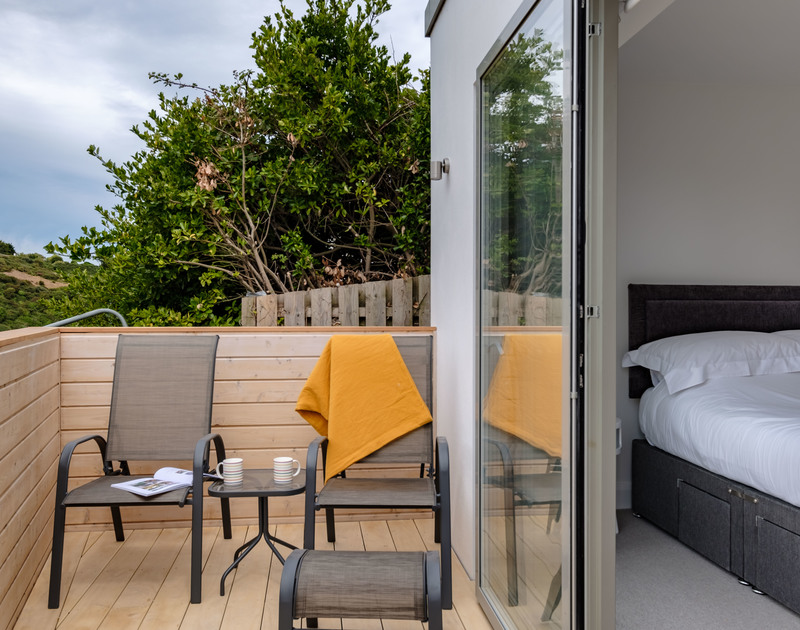 Glass patio doors lead out to the ground floor terrace from both bedrooms at Backwater in Polzeath.