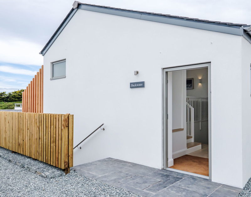 The gravel and slate entrance and parking at Backwater, a holiday rental in Polzeath, Cornwall.