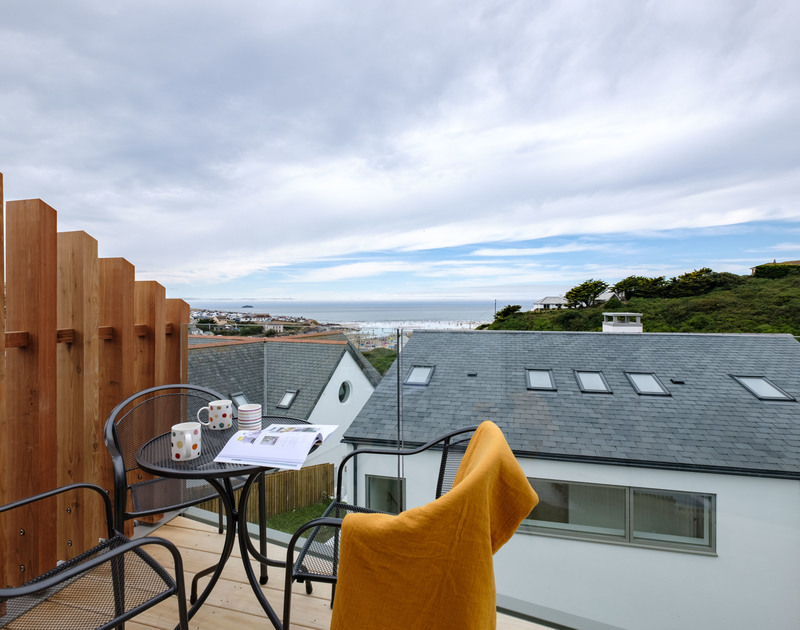 Alfresco dining from the terrace with views of the surf at Backwater, a luxury holiday rental in Polzeath, Cornwall.
