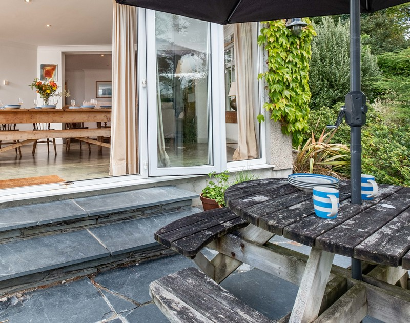 Take breakfast or coffee out onto the table on the slate terrace at self catering, holiday property Bodare 1 in Daymer Bay, Cornwall.