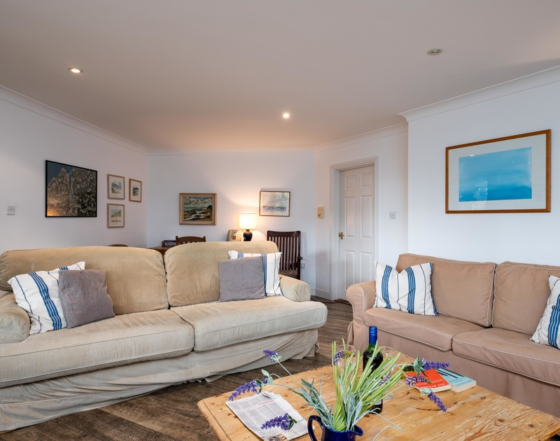 Squidgy sofas to relax and recline on at holiday property Bodare 1 an open plan, ground floor holiday apartment on Daymer Lane.