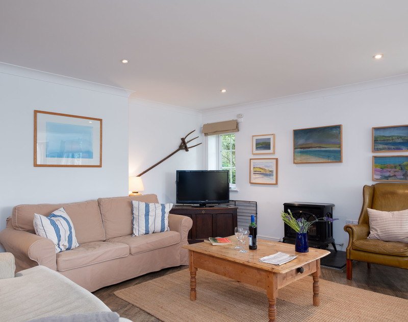 The supremely comfortable sitting room of Bodare 1, a holiday apartment to rent at Daymer Bay, Cornwall