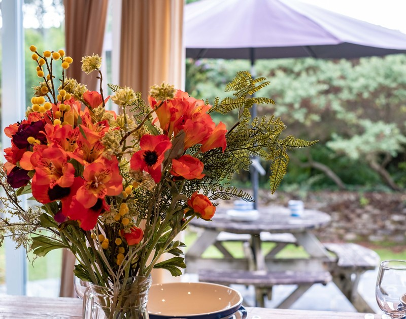 Pretty garden flowers on the table at Bodare 1 situated in Daymer  Bay, Cornwall.