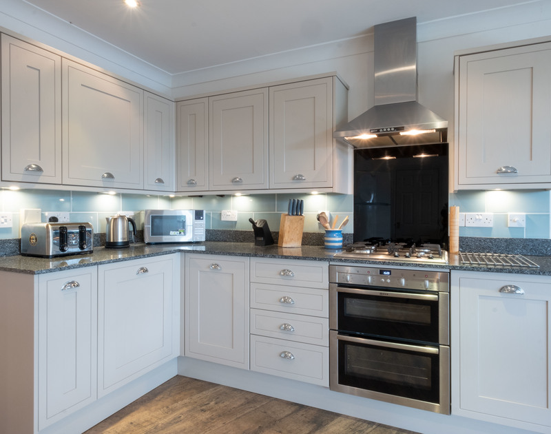 Prepare family meals in the well appointed, kitchen at Bodare 1, a luxurious and spacious holiday apartment just a short stroll from the beach at Daymer Bay.