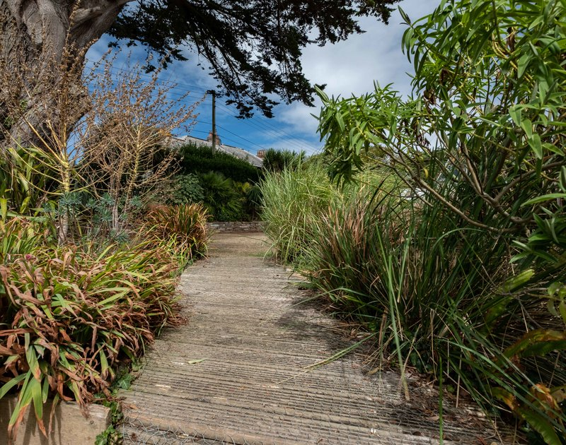 Take the non slip walkway through the mature gardens at Bodare 1 on Daymer Bay in north Cornwall.