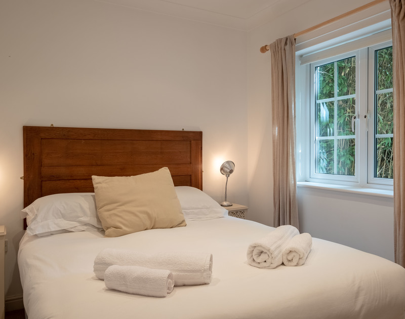A cosy double bedroom at Bodare 1, a seaside holiday apartment at Daymer Bay, Cornwall