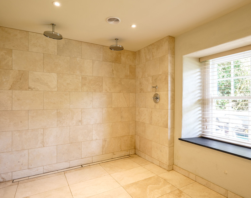 Plenty of room in the fabulous double headed walk in shower at self catering, holiday house to rent Old Farm in North Cornwall.