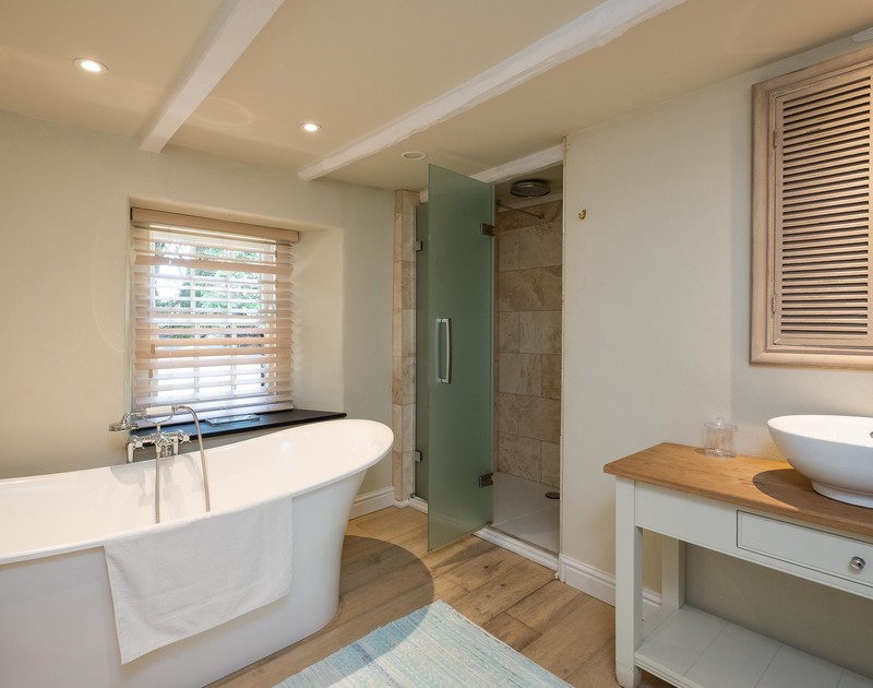 The luxurious bathroom at Old Farm, a holiday house at Daymer Bay, Cornwall, with its freestanding bathtub.
