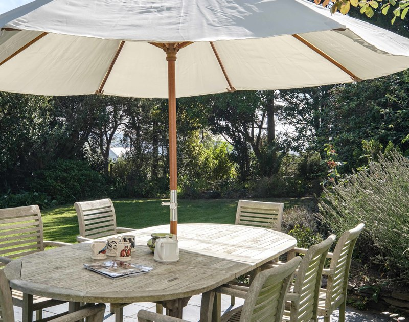 The mature garden at Old Farm in Daymer Bay has outdoor furniture for enjoying the sunshine or shade.