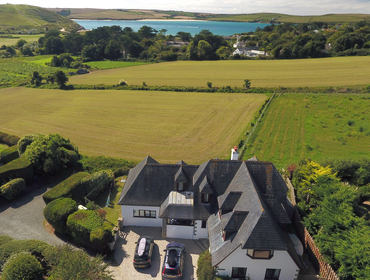 A birds eye view showing the vast size of holiday property Seaworthy and its fantastic setting, only a couple of fields walk away from the sands and sea at Daymer Bay in Cornwall.