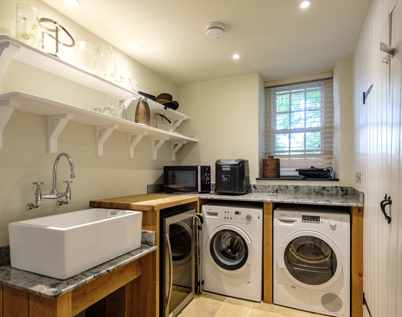 Polished granite worktops, lots of shelving and all the usual white goods you'd expect in an extremely, well appointed utility room at Old Farm.
