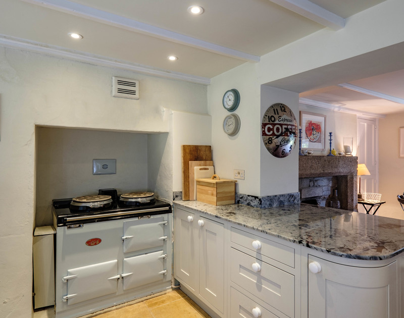 Welcoming, warm, traditional AGA in the kitchen at Old Farm, a self catering, family holiday house at Daymer Bay in Cornwall.
