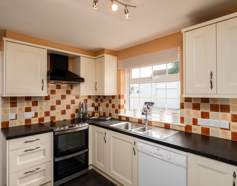 The well-equipped, practical, attractive kitchen at Whiteaway, a holiday house to rent near Rock, Cornwall