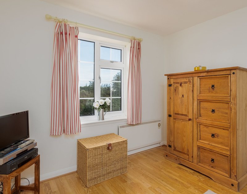 Enjoy the countryside view from the peaceful TV/reading room at self catering, traditional holiday house Whitehay in Rock, Cornwall.