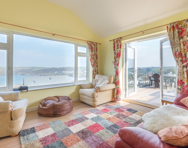 Beautiful views over the sea and french doors out onto the decked balcony at self catering holiday house Stradav in Polzeath.