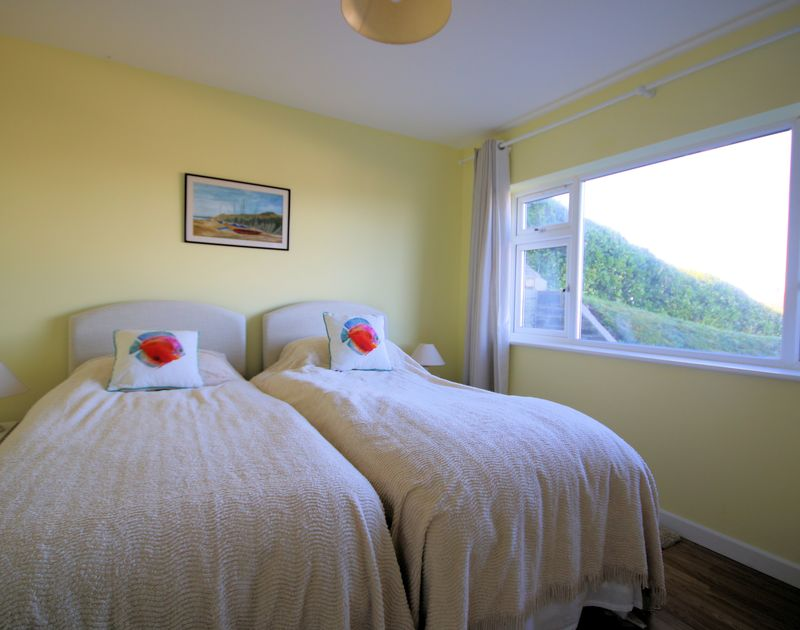 A twin bedroom at Stradav, a self catering, family holiday house by the sea in Polzeath, Cornwall.
