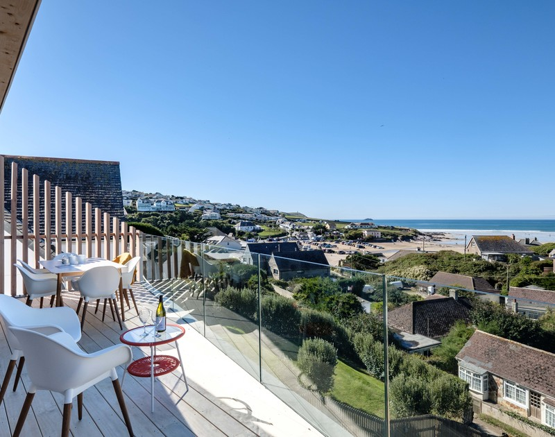 The glazed balcony and view of Polzeath beach from Slatewater,  a newly built holiday home overlooking Polzeath beach, Cornwall