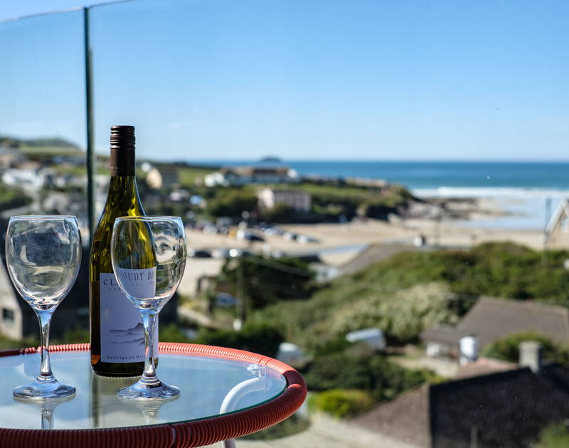 Have a glass or two on the first floor balcony at Slatewater in Polzeath and admire the views over the beach and out to sea on the North Cornish Coast.