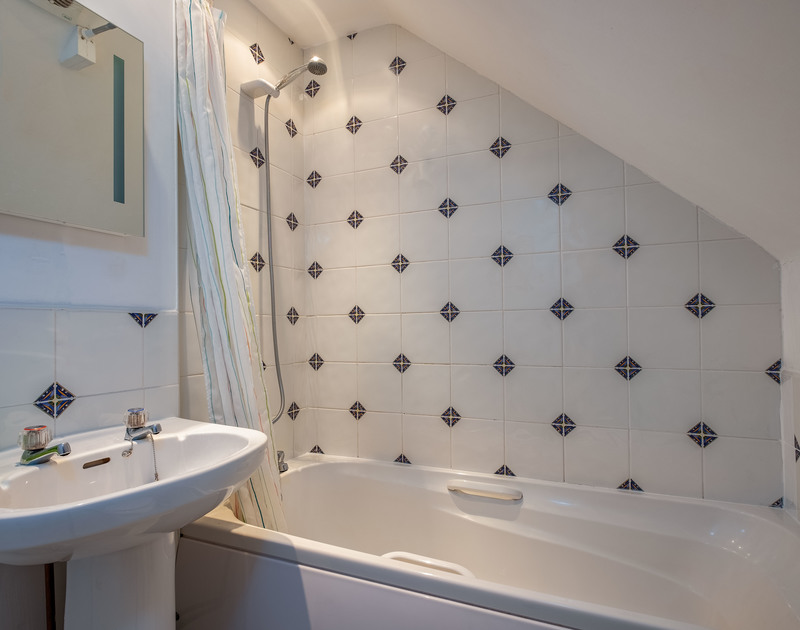 The bathroom for the king sized bedroom at self catering holiday home Westpoint at Polzeath in North Cornwall.