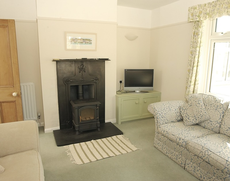 The attractive woodburner in the elegant lounge at Trevian, a self actering holiday rental in Rock, North Cornwall.