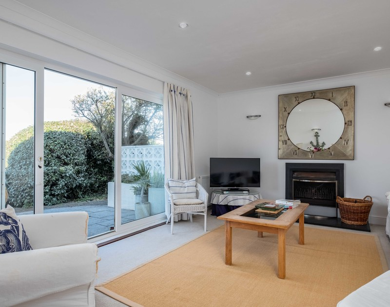 The sitting room with sliding glass doors at Westpoint, a self catering holiday house to rent close to the beach at Polzeath in Cornwall.