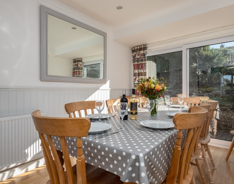Gather the family around the table in the dining room at Westpoint, a self catering holiday house to rent within walking distance of the beach and surf at Polzeath in Cornwall.