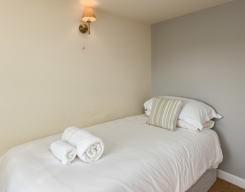 Cosy, single bedroom at self catering, family, holiday house to rent close to the Camel Estuary at Daymer Bay.