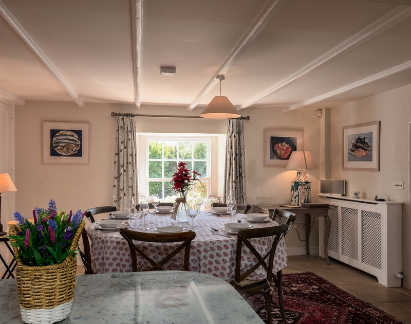 Tastefully furnished and decorated dining room at Old Farm with plenty of light coming in from the pretty sash window.