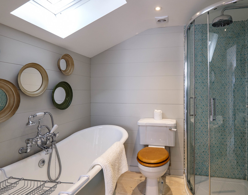 Fabulous roll top bath in the bathroom ensuite for bedroom 5 at Old Farm, a luxury, self catering, holiday house in Daymer Bay, North Cornwall.