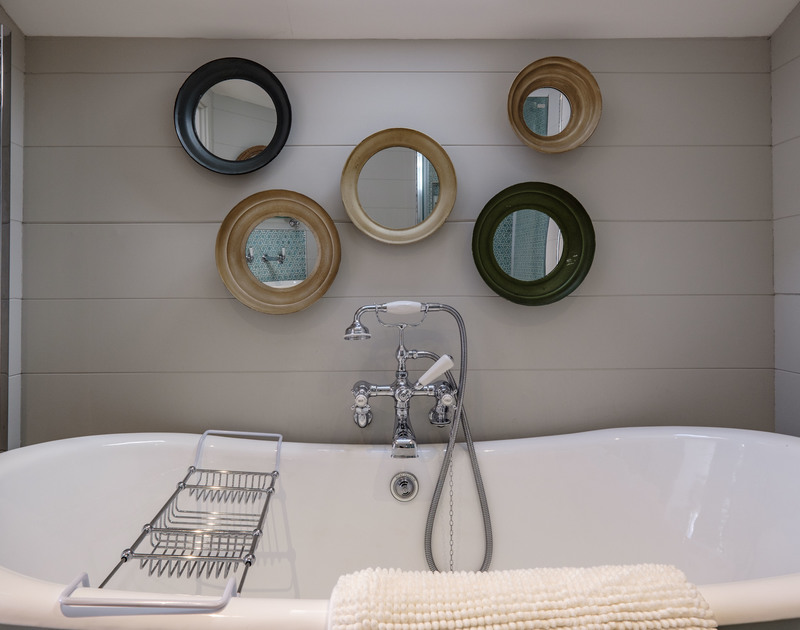 Luxurious roll top bath with central taps and shower attachment at Old Farm, a traditional, renovated holiday property to rent in Daymer Bay.