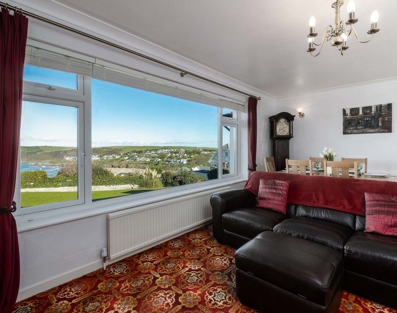 The large lounge window at Hillview with views over the beach towards New Polzeath and Pentire Headland.